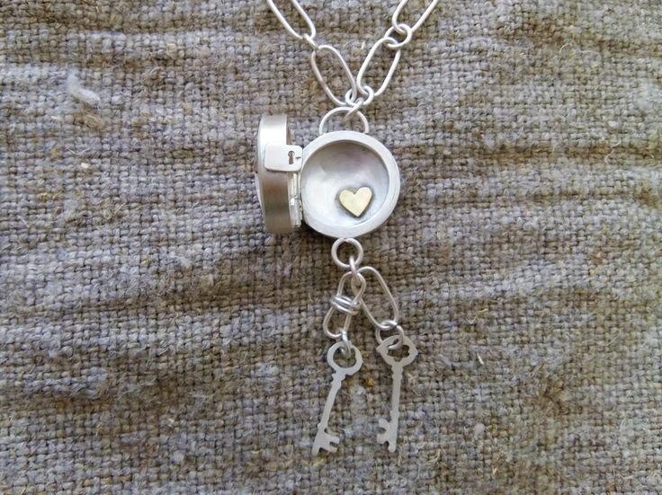 Handmade Sterling silver and 18 carat gold locket and chain