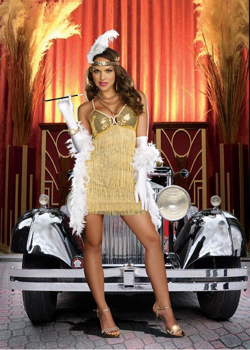 #8421 Become the sexy Vaudeville Vixen this Halloween. The Vaudeville Vixen Costume includes a gold fringed dress with sequin bodice and exquisite rhinestone trim. The head piece with ostrich feather