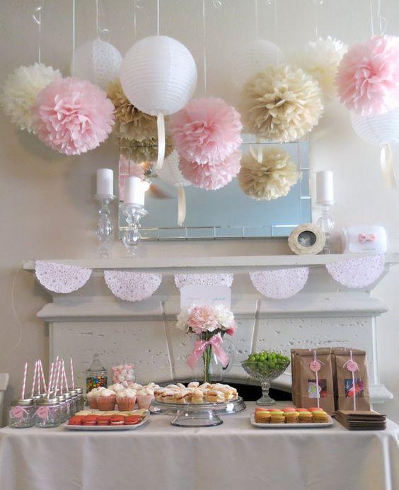 Blush Paper Pom-Poms Wedding Decor / http://www.himisspuff.com/pom-poms-decor-ideas-for-your-wedding/7/