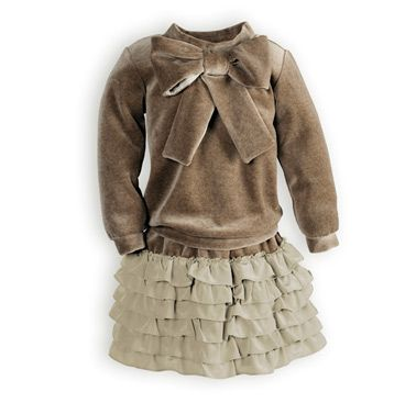 Soft and stylish taupe cotton velour skirt set. Large pre-tied bow accents top at neckline. Pull-on velour skirt with soft poly crepe ruffles. Above k