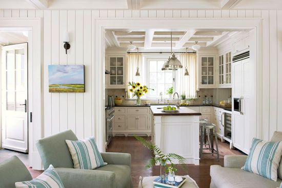 This cozy kitchen flows right into a lovely sitting area - Traditional Home®