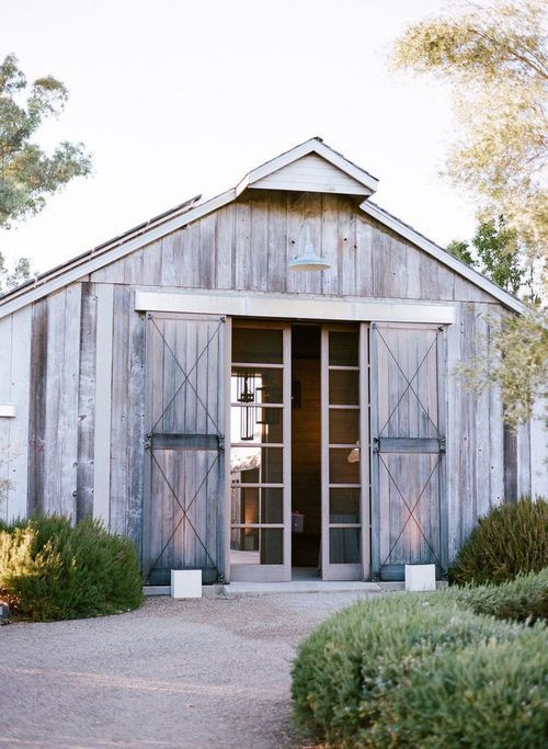 Complex in its interpretation, this home has a mixed identity. On the outside, it is an old barn. However, this old farmhouse image is contradicted with these modern steel doors. More