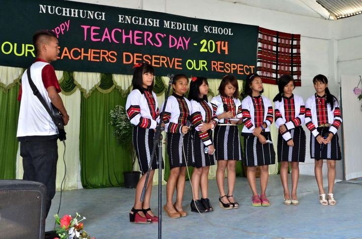 Mizo school girls in Mizo traditional dress perform group singing. Mizo hnam incheina hi a lo nalh ber mai.