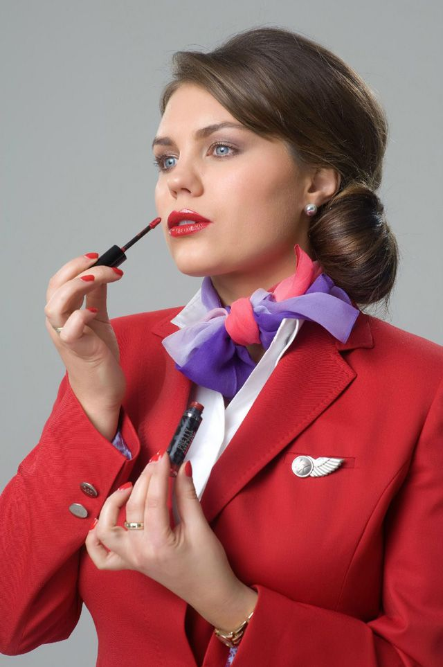 """Virgin Atlantic has collaborated with bareMinerals to produce Upper Class Red, a lipstick that matches the uniform of Virgin Atlantic's cabin crew. It is available for sale at several Virgin Atlantic Clubhouse Spas """"before being made available for pre-order on board Virgin Atlantic flights through Retail Therapy."""""""