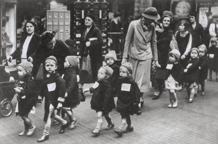 Children from a nursery school in Kentish Town, London, are evacuated. Notice their labels.
