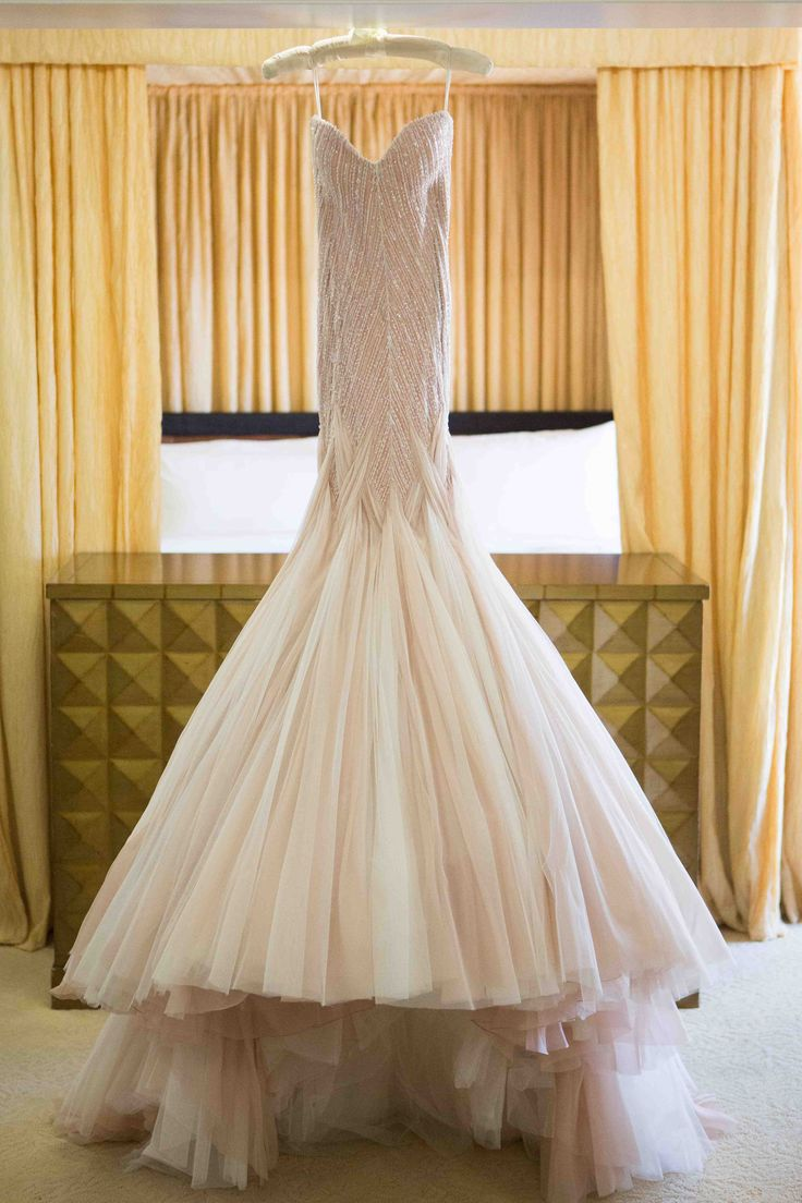 Strapless, Blush Gown with Crystal Beading on Hanger | Photography: Christine Bentley Photography. Read More: http://www.insideweddings.com/weddings/tamra-barney-and-edward-judge/471/