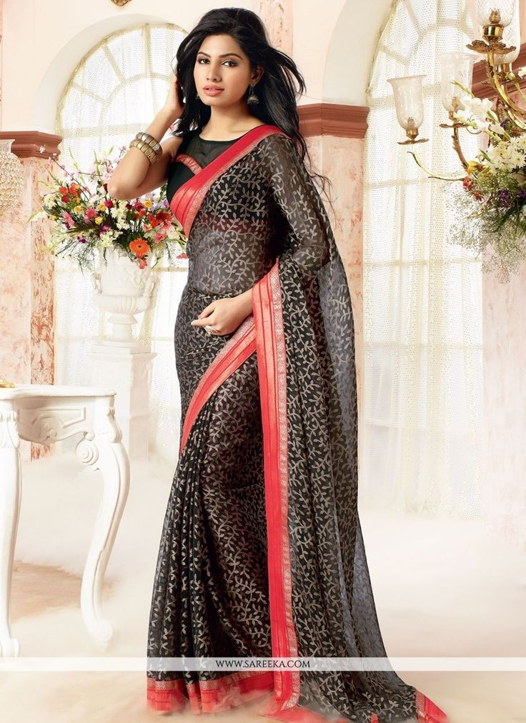 We unfurl our the intricacy and exclusivity of our creations highlighted in such a lovely black brasso georgette and faux chiffon casual saree.. The attractive patch border and print work all through ...