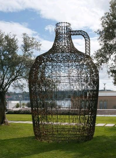 The Carboy (Mr. Wine) created by the artist Joana Vasconcelos was commissioned by the city of Torres Vedras to be installed in the new city market as a piece of public sculpture. This work, about five feet tall, was designed with iron fences inspired by the patterns of typical Portuguese houses.