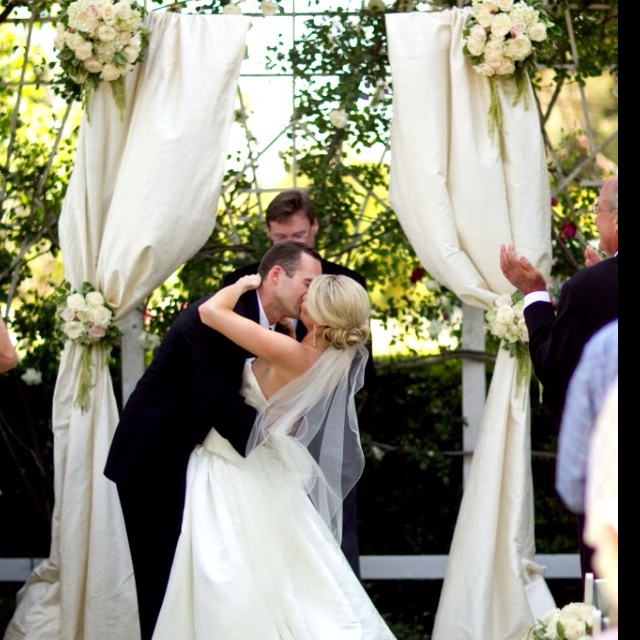 White/Ivory curtains draped on pergola, tied back with white and green hydrangeas!