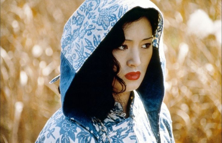 Charming Gong Li ... Classy Hairstyles... While a student at the Central Academy of Drama, she was discovered by Zhang Yimou, who chose her for the lead role in Red Sorghum, his first film as a director