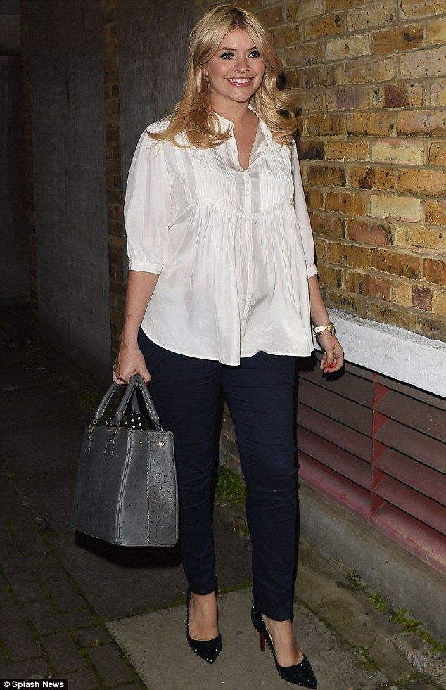 Blooming lovely: Pregnant Holly Willoughby kept her bump hidden as she left the ITV studios after filming Celebrity Juice on Wednesday