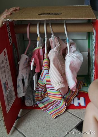 Did your kids get doll clothes for Christmas? Help them make this super-simple cardboard wardrobe to store them!