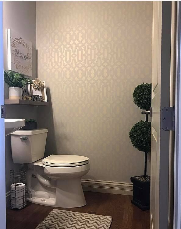 A soft shimmering accent wall in a bathroom using the Trellis Wall Stencil from Cutting Edge Stencils. Project by Beautiful on the Inside.    http://www.cuttingedgestencils.com/allover-stencil.html