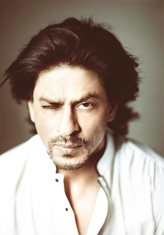 Shah Rukh Khan: the wink doesn't work with this pose Khan. But the stud stubble does.