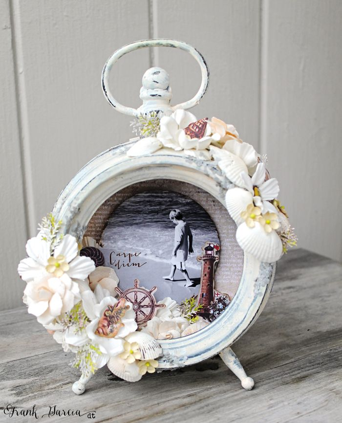 Altered clock I made using the French Riviera collection and metal clock by Prima. Seahsells, lumies, die cuts, flowers