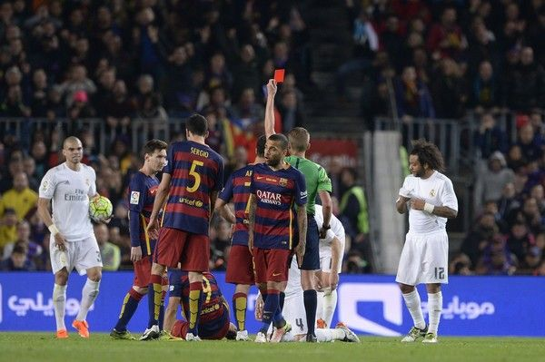 "Real Madrid's defender Sergio Ramos is shown a red card by the referee during the Spanish league ""Clasico"" football match FC Barcelona vs Real Madrid CF at the Camp Nou stadium in Barcelona on April 2, 2016."