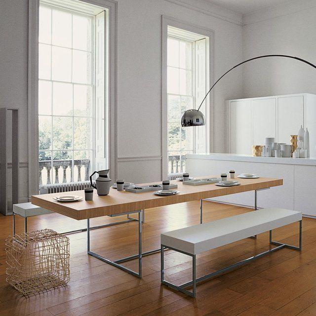 Moderno com uma interferência de madeira dando um ar natural, leve e aconchegante ao ambiente frio e claro. Athos Dining Table by Paolo Piva