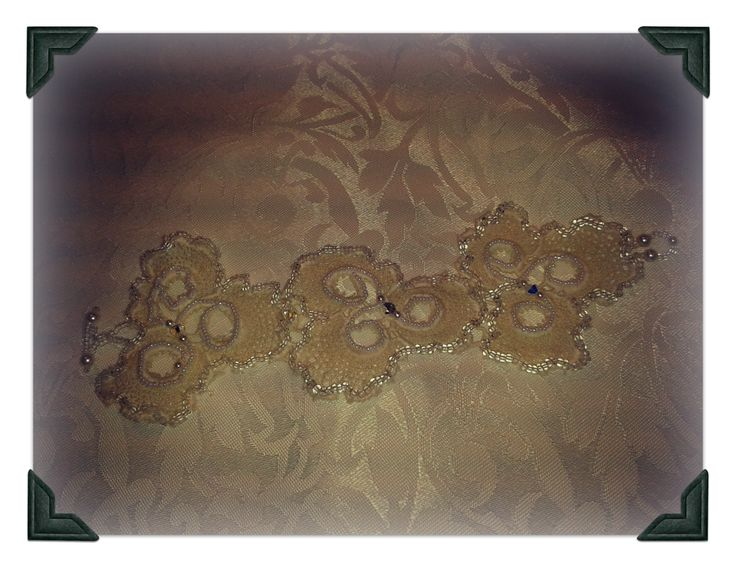 Lace cuff.  Embroidered with lots of little beads with crystals and pearls.  Perfect wedding piece.