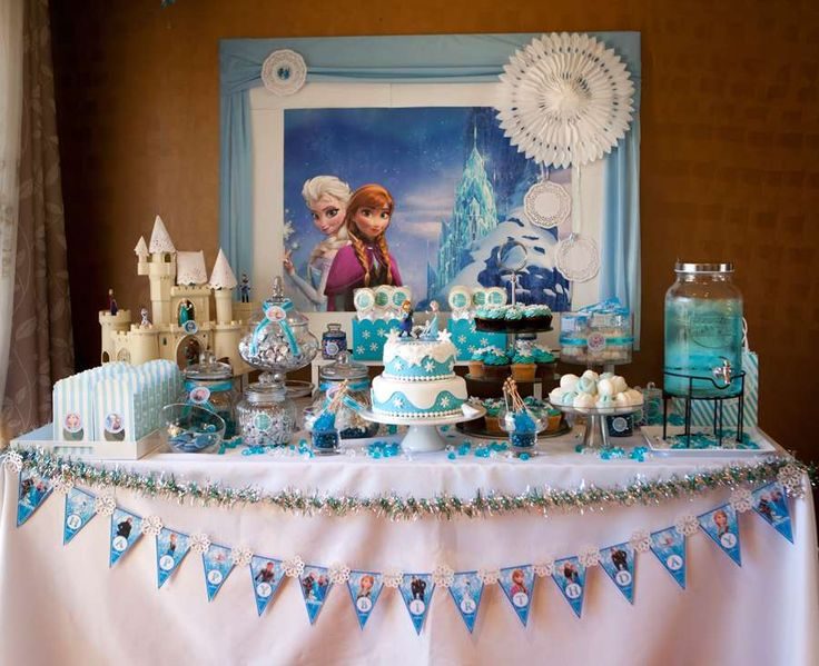 Frozen girl birthday party dessert table and backdrop. CatchMyParty.com
