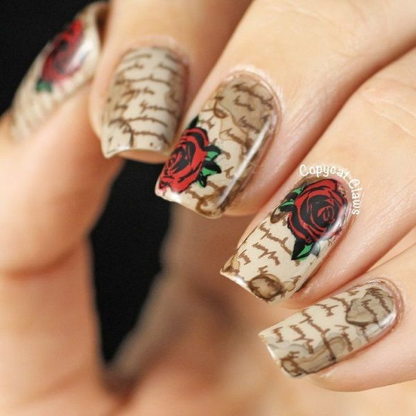 A really beautiful typography inspired rose nail art design. The nails look like old book pages with red roses painted on top of them. This is surely a design which book and antique enthusiasts will love.