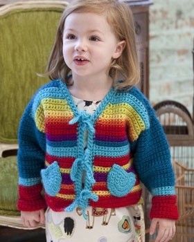 Brighten up kids' wardrobes with this vibrant, playful rainbow sweater. Shown in Bernat Sheep(ish) by Vickie Howell.