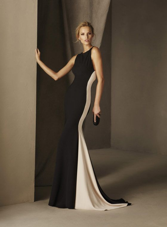 CARTAGO - Seductive long crepe gown with a sleeveless mermaid silhouette and bateau neckline A criss-cross back sends a seductive message. An ideal choice for an evening celebration.
