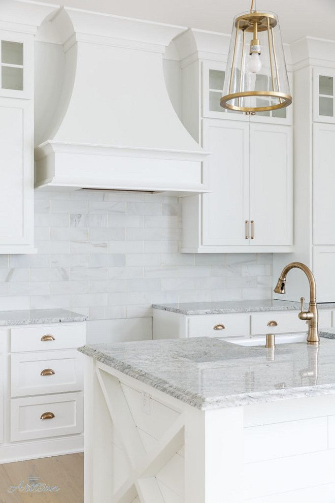 The countertops are a white granite called Salinas, back splash is honed marble.