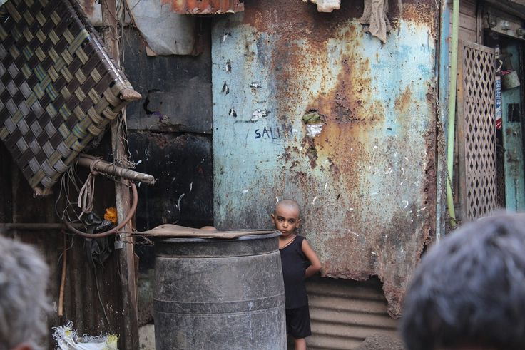 "The Face of Dharavi ""A child reflects the poverty of Dharavi, Asia's largest slum, outside of Mumbai, India."" @Sydney Hubbell"