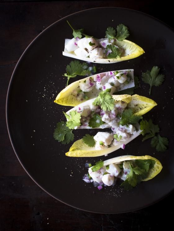 Halibut Ceviche with Lime Serves 4 3/4 pounds halibut (or any firm-fleshed fish), cut into 1/4-inch cubes 1/3 cup Key or other lime juice 2 jalapeños or other hot peppers 1 small red or white onion, peeled and diced 6 sprigs cilantro, coarsely chopped Salt, to taste Raw Belgian endive leaves