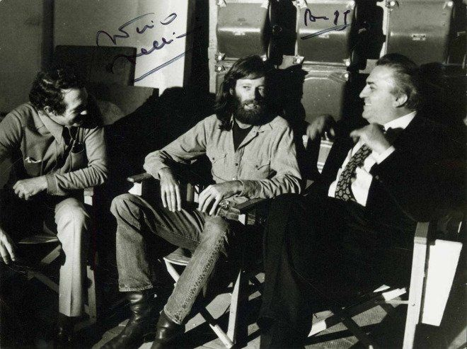 Warren Oates, Peter Fonda and Federico Fellini on the set of 'Roma' in Cinecittà, Rome