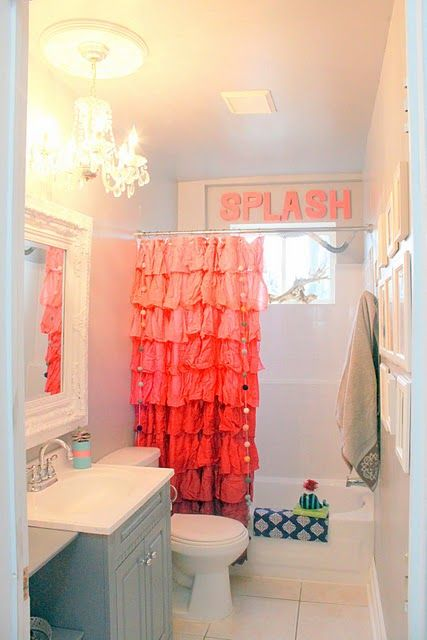 """adorable bathroom!!!!!!!!!! love the color combo, where they placed the word """"splash"""" and the little string of pom poms on the shower curtain! oh and the wall of pictures ( it would be cute if they were pic of the kiddies in the tub)!"""