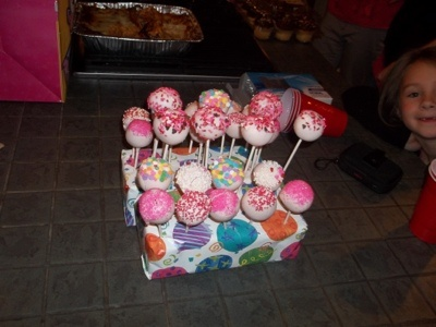 Funfetti Birthday cake pops recipe; SO easy  Bake a cake/cupcakes using cake mix. When cooled, just dump in a bowl, crumble up, and mix well with 1 container of frosting. Roll into golfball sized balls  Dip stick in melted candymelts/almond bark, and halfway into cake balls. Dip in melted candy, sprinkle with toppings.