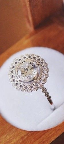 Love the unique feel of this vintage-inspired diamond engagement ring.