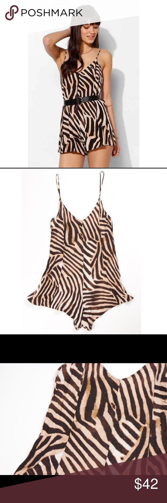 "Somedays Lovin fight animal print brown romper Somedays Lovin ""Fight Animal"" print romper. Adjustable straps. Zips up the back. 100% viscose. Size xs. *Belt not included  Bust-30 Waist-30 Hips-34 Rise-12 Inseam-4 Length-28 Somedays Lovin Pants Jumpsuits & Rompers"