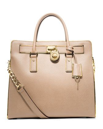 years later, I still can't get enough of this bag and shape. it is timeless and so classic chic!  MICHAEL Michael Kors: Large Hamilton Trimmed Tote
