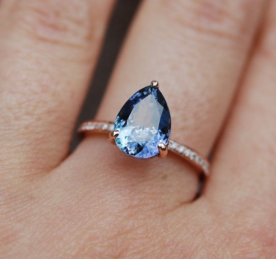 Tanzanite ring. Rose gold engagement ring. Eidelprecious ring.  This Tanzanite is natural certified pear cut stone. The cut is mesmerizing, making