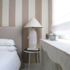 casa Fiori: Camera da letto in stile in stile Mediterraneo di Studio Matteoni