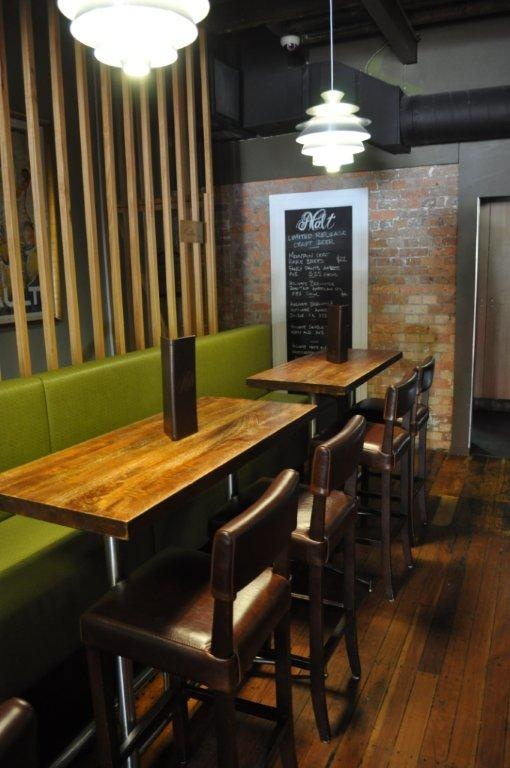 Manchu Bar tops accompanied by our leather bar stools.