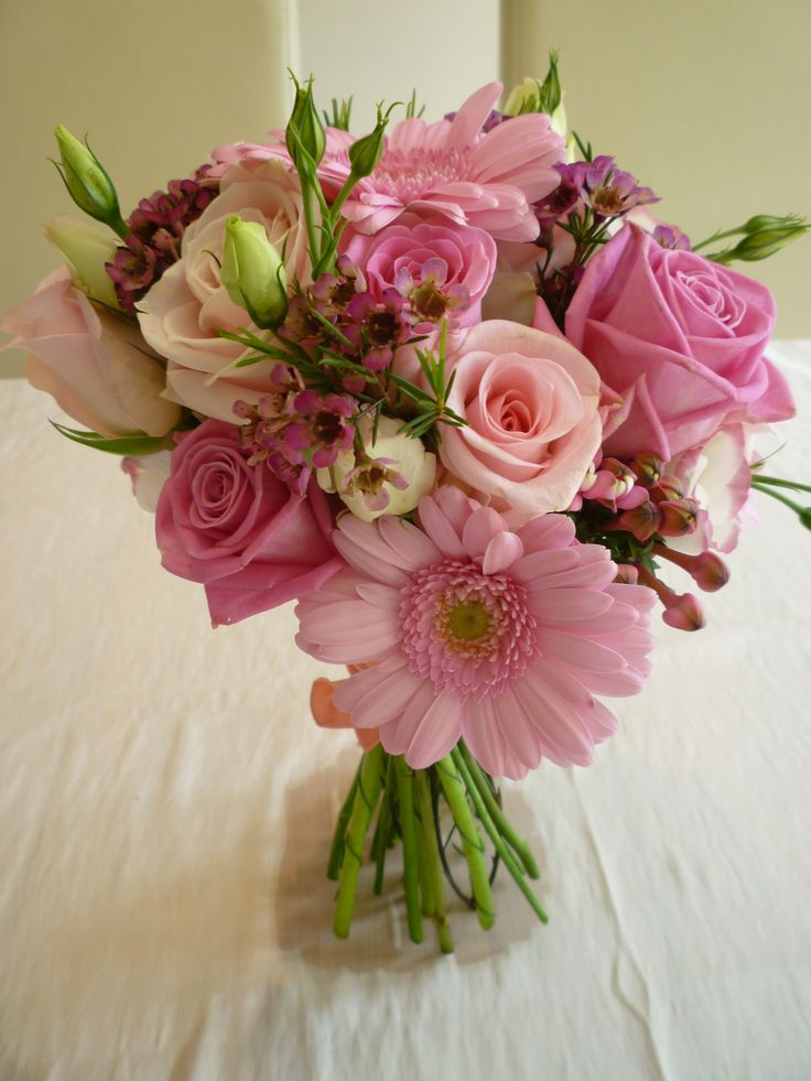 Mixed pink bridal bouquet made with roses hydrangeas and eustomas. Chanan's Floral Events