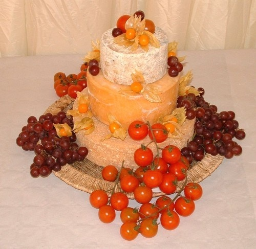 non-traditional cheese wheel cake...serve with wine and it would make a nice sophisticated reception