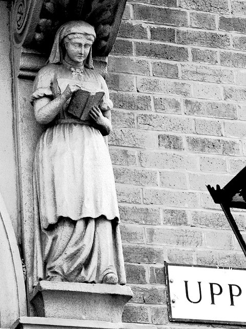 Woman-Reading--Above door at Upperthorpe Library Crookesmoon, Sheffield, England, photo by Trois Tetes on flickr