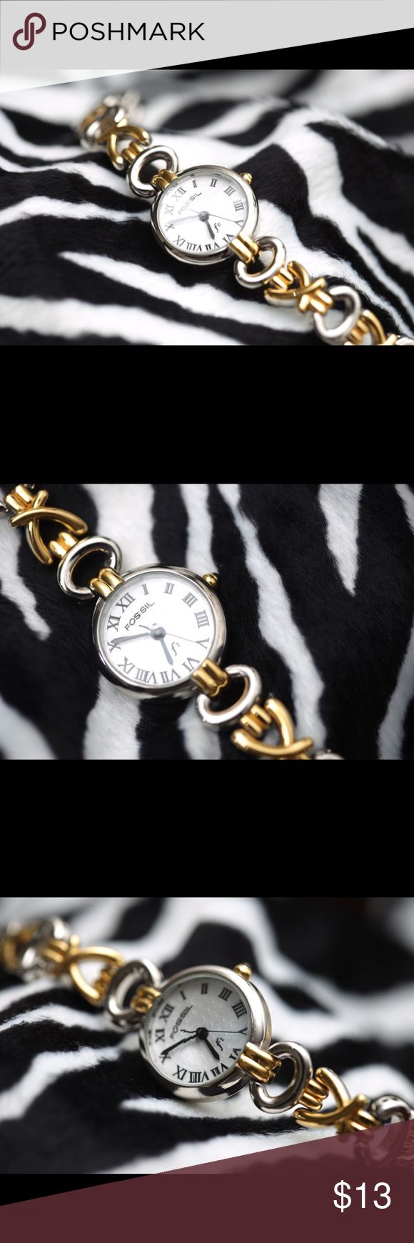 Fossil watch This is a gently used wrist watch for ladies. It has silver tone and gold tone hardware. Note this is not real silver or gold. Fossil Accessories Watches