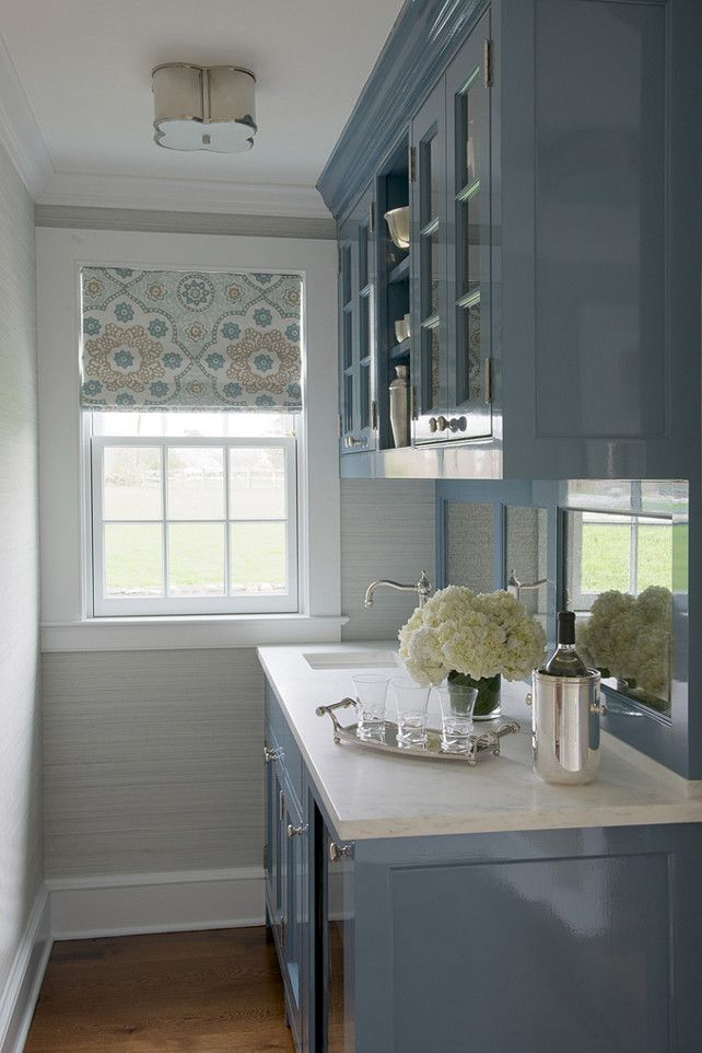 love the grass cloth wall covering & steely blue gray cabinets in this butler's pantry.  Designed by Kerry Hanson.