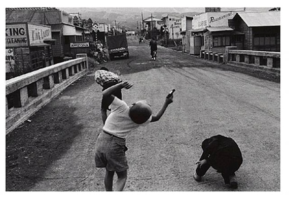 Kids playing on a bridge. by Shigeichi Nagano. Japan