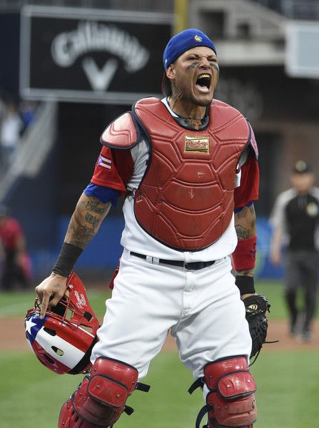 Yadier Molina Photos Photos - Yadier Molina #4 of Puerto Rico reacts after tagging Jean Segura #2 of the Dominican Republic  out at the plate during the first inning of World Baseball Classic Pool F Game One between the Dominican Republic and Puerto Rico at PETCO Park on March 14, 2017 in San Diego, California. - World Baseball Classic - Pool F - Game 1 - Dominican Republic v Puerto Rico