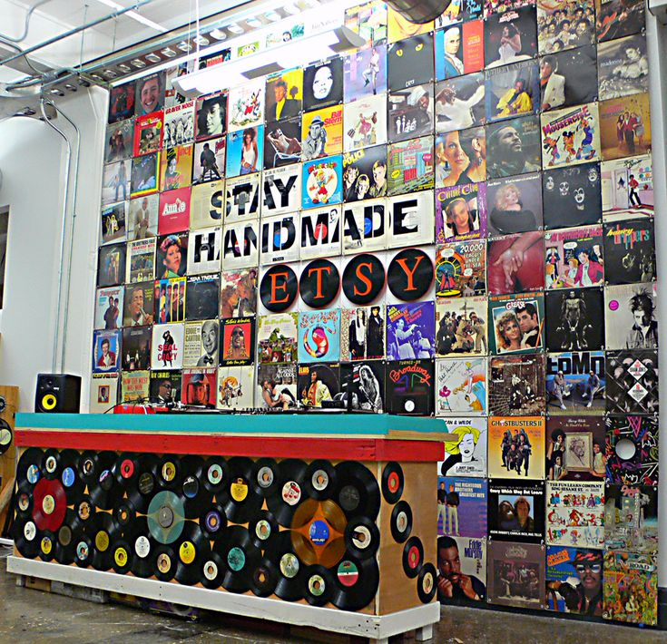 a backdrop of record albums and vinyl