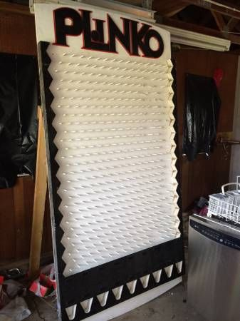 Plinko dowel rods inserted into a peg board and painted for Plinko board dimensions