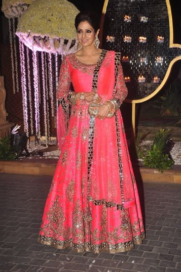 Sridevi in Manish Malhotra You're never too old to wear fluro - Sridevi shows us how to pull off a fluro orange/pink floor-length anarkali with grace at Ridhi Mehra's wedding. Indian wedding - Bollywood wedding #thecrimsonbride