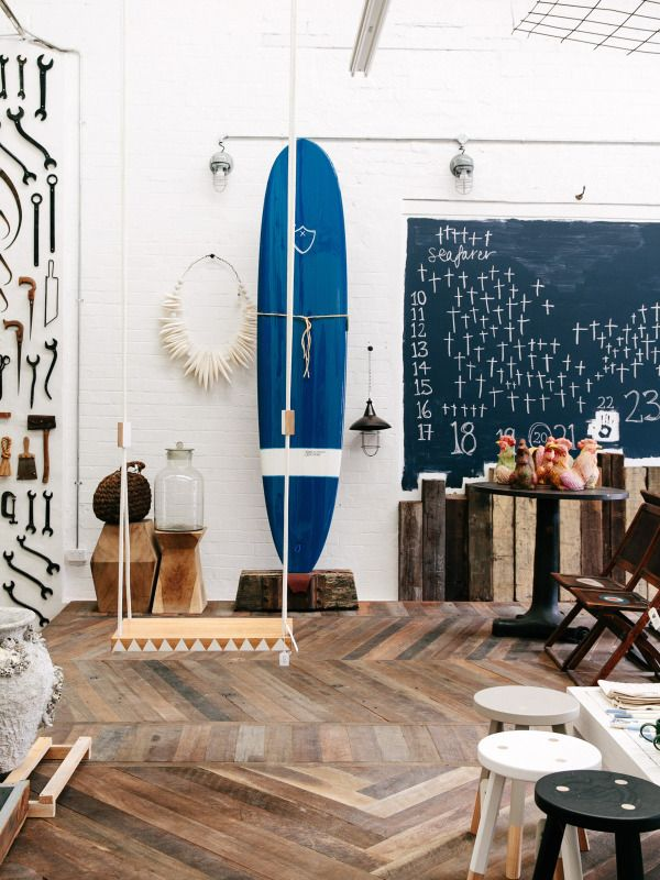OMG! The blue surfboard is orgasmic! And the chevron wood floor is to die for!: