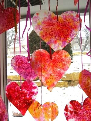 I love hanging these crayon shaving hearts in my windows. This fun craft is a great way for gets to help decorate! #yearofcelebrations www.skiptomylou.org